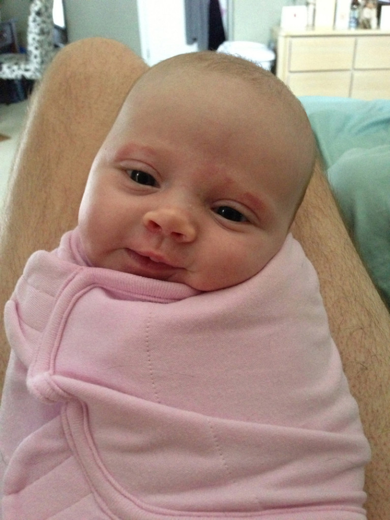 Smiling in her swaddle