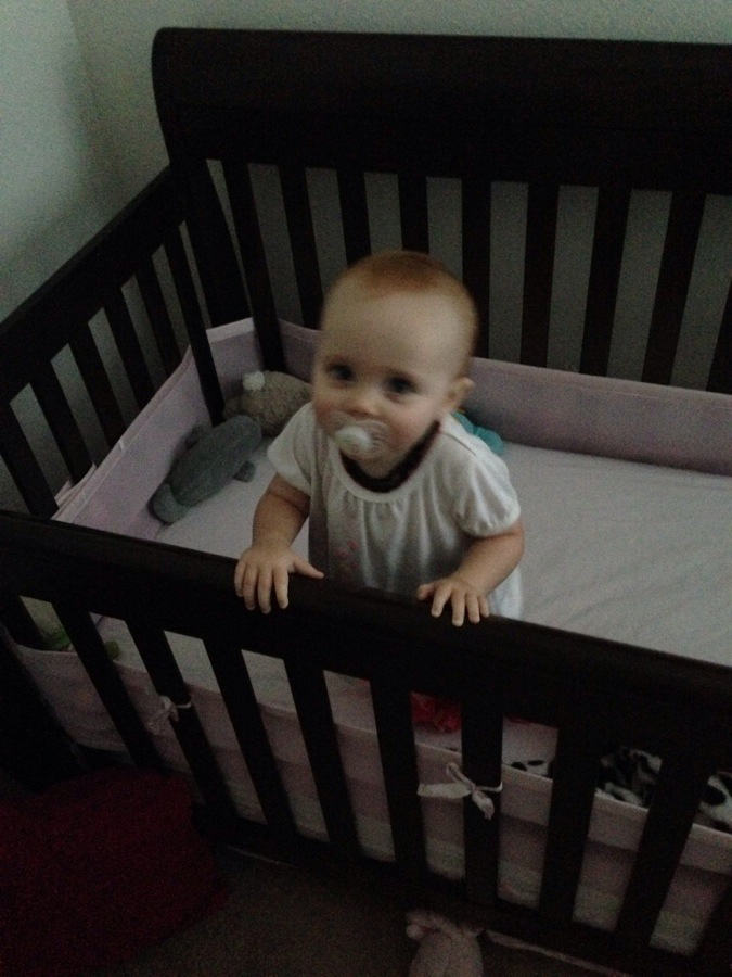 Standing in her crib