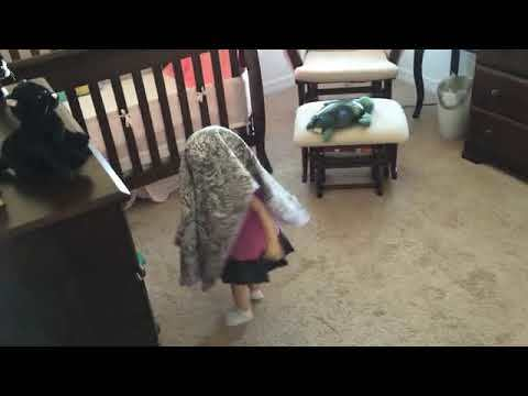 Walking around with a blanket on her head [VIDEO]