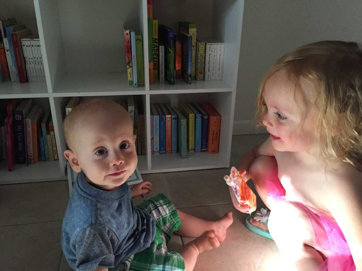 Being a great big sister by feeding Jack