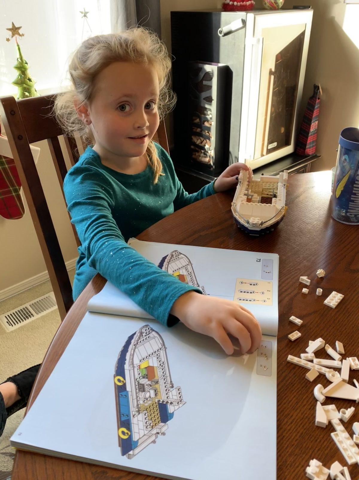 Ellie building a Lego yacht