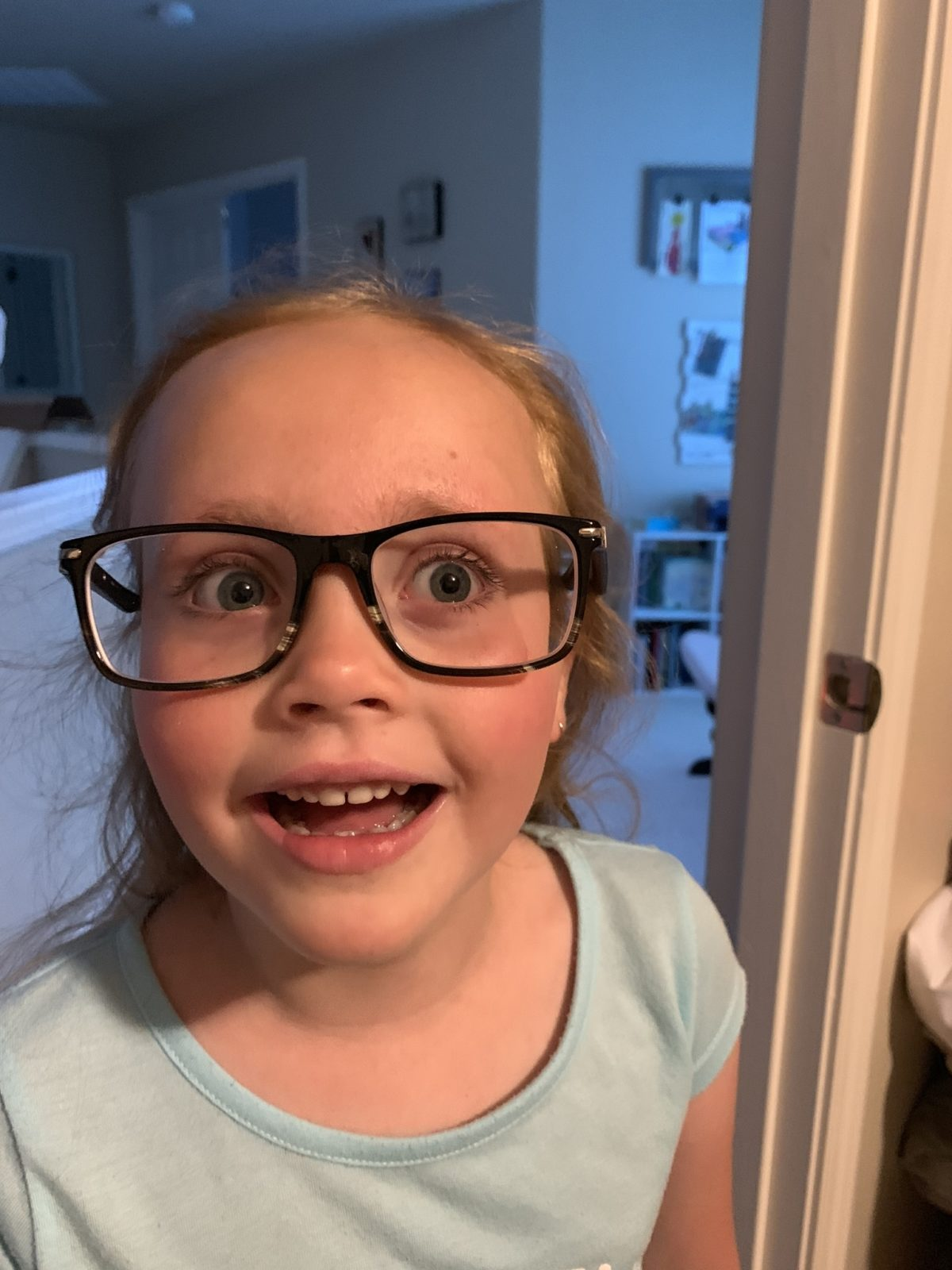 Trying Daddy's glasses